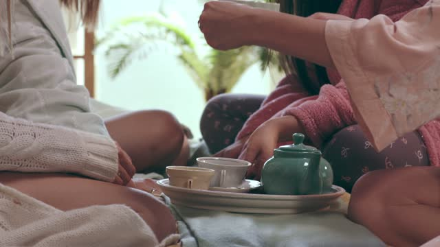woman serving tea in bed for friends - slumber party stock videos & royalty-free footage