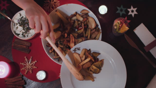 woman serving vegetarian christmas dinner - christmas meal stock videos & royalty-free footage