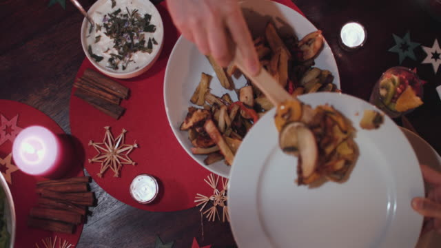 woman serving vegetarian christmas dinner - sweet potato stock videos & royalty-free footage