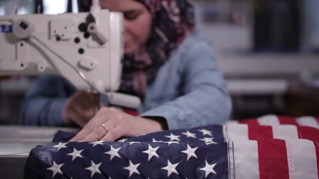 woman sewing american flag - made in the usa short phrase stock videos & royalty-free footage