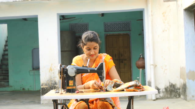 woman sewing clothes with sewing machine - cucire video stock e b–roll
