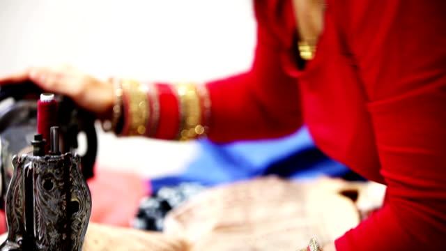 Woman sewing cloths
