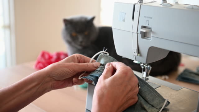 woman sewing covid-19 masks at home - sewing machine stock videos & royalty-free footage