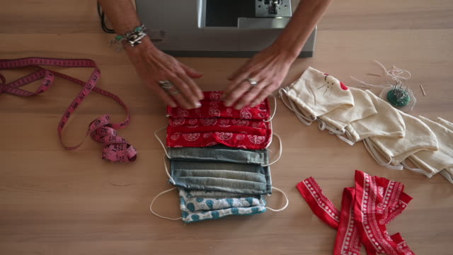 woman sewing covid-19 masks at home - a helping hand stock videos & royalty-free footage