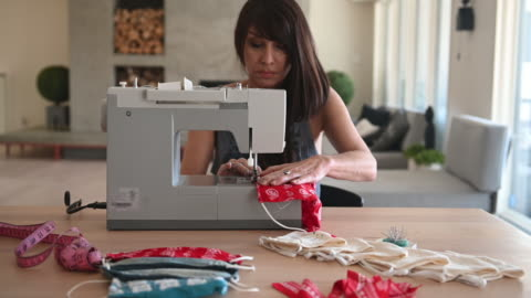 woman sewing covid-19 masks at home - home made stock videos & royalty-free footage