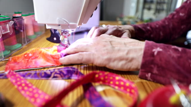 woman sewing face masks during coronavirus pandemic - solution stock videos & royalty-free footage