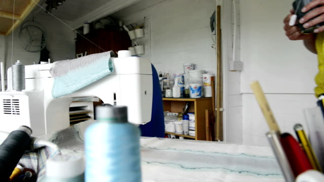 woman sewing on machine - one mature woman only stock videos & royalty-free footage