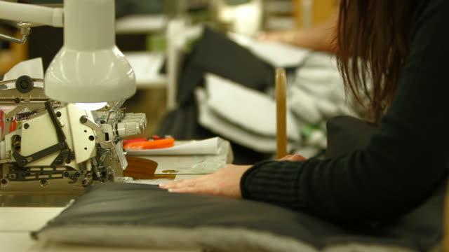 ds cu of woman sewing winter coat - デザイナー服点の映像素材/bロール