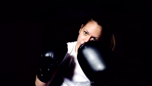 woman shadow boxing - sports glove stock videos and b-roll footage