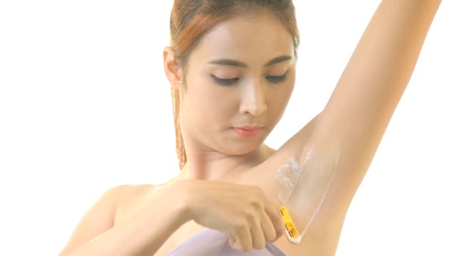 woman shaving armpit with razor isolated - shaving stock videos and b-roll footage