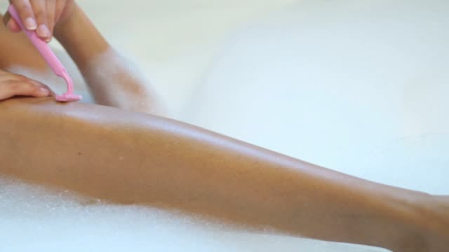 kdaf woman shaving her legs - shaving stock videos & royalty-free footage