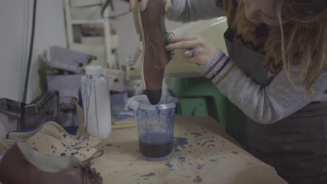 woman shoemaker - workbench stock videos & royalty-free footage