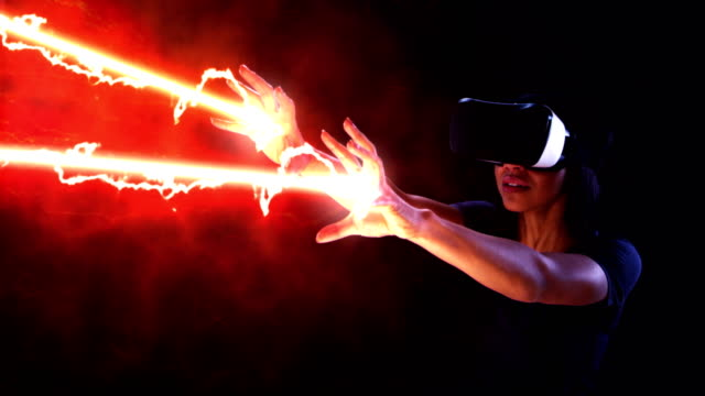 Woman shooting laser beams. Virtual reality simulation