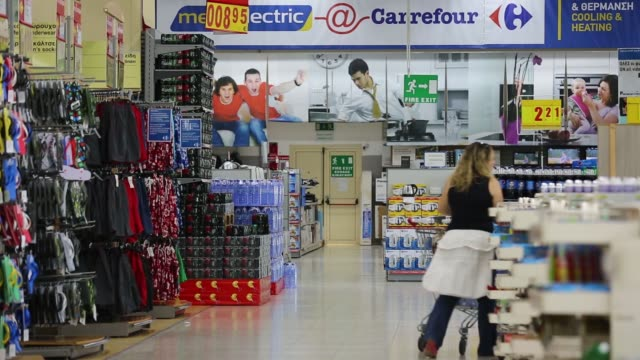a woman shopper pushes a shopping cart through aisle inside a carrefour sa supermarket part of the marinopoulos group in limassol cyprus on monday... - cart stock videos and b-roll footage