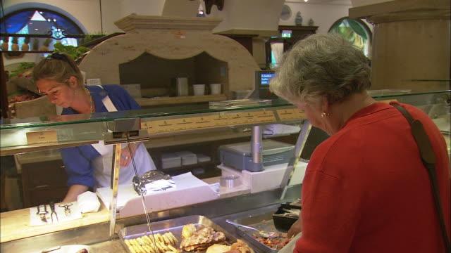 ms woman shopping at dallmayr, luxury delicatessen, munich, bavaria, germany - skåp med glasdörrar bildbanksvideor och videomaterial från bakom kulisserna