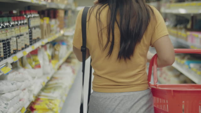 woman shopping at supermarket - stereotypical homemaker stock videos & royalty-free footage