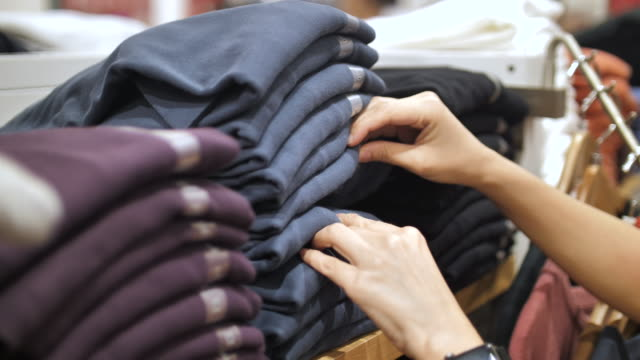woman shopping clothes, close-up - maglietta video stock e b–roll