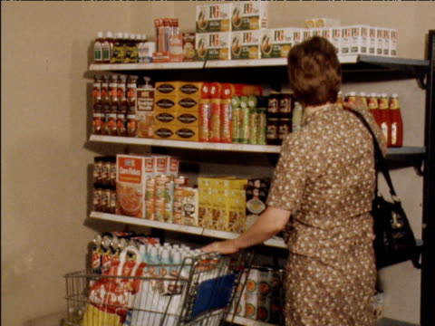 woman shopping for groceries in supermarket. 25 july 1979. - preparation stock videos & royalty-free footage