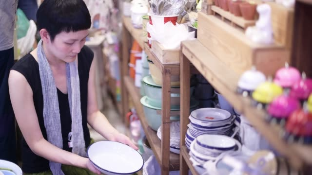 woman shopping for home decoration - kitchenware department stock videos and b-roll footage
