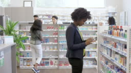 Woman shopping for medicine at drug store