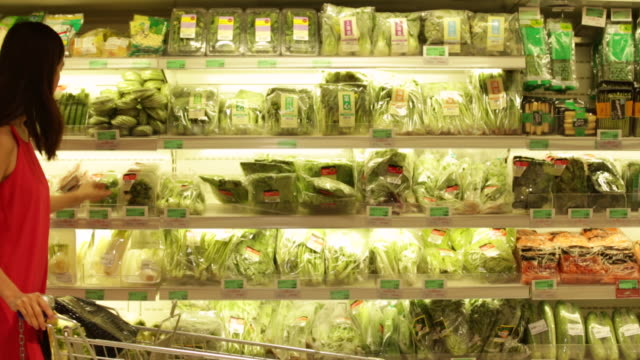 ms woman shopping for vegetables in a grocery store. - choice stock videos & royalty-free footage