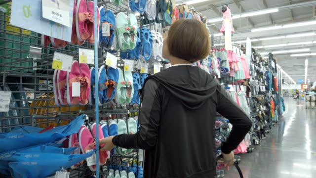 woman shopping in a clothing store - shopping basket stock videos and b-roll footage