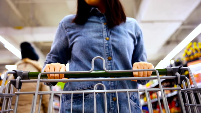 woman shopping in a supermarket - cart stock videos & royalty-free footage