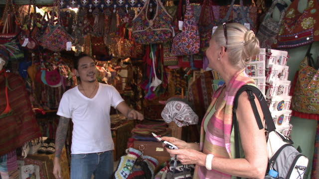CU ZO Woman shopping in gift shop, Bangkok, Thailand