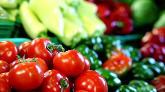 woman shopping in greengrocer's shop - pepper vegetable stock videos & royalty-free footage