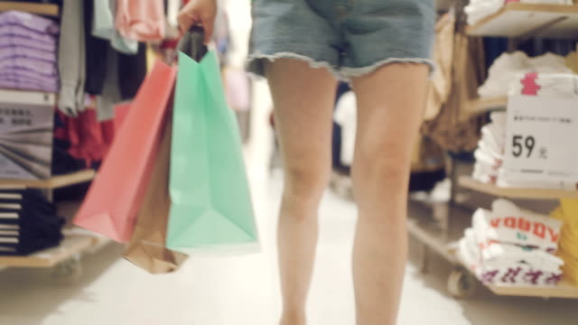 woman  shopping in mall - clothes shop stock videos & royalty-free footage