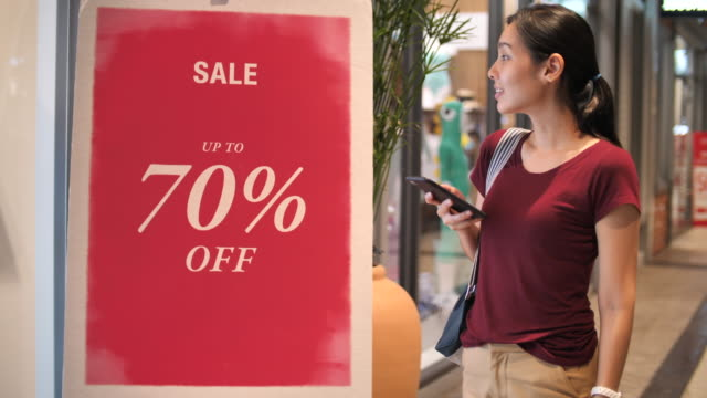 woman shopping in mall with sale label - animal skin stock videos & royalty-free footage