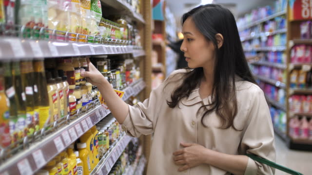 woman shopping in supermarket - choosing stock videos & royalty-free footage
