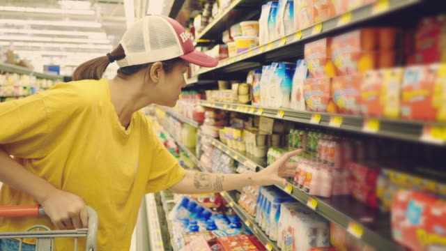 woman shopping in supermarket - refreshment stock videos & royalty-free footage