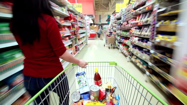 woman shopping in supermarket - shopping trolley stock videos and b-roll footage