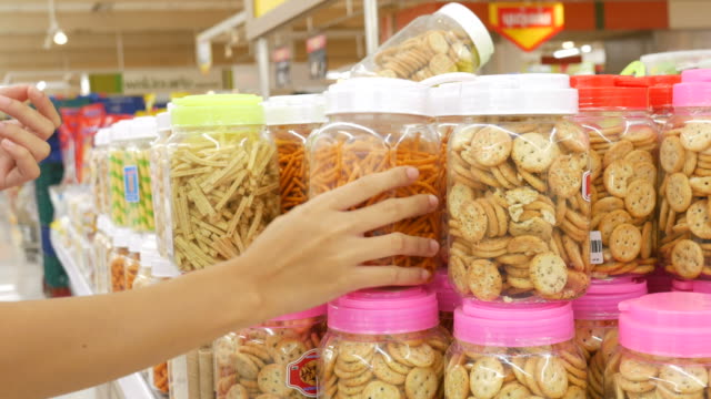 woman shopping in supermarket - snack stock videos & royalty-free footage