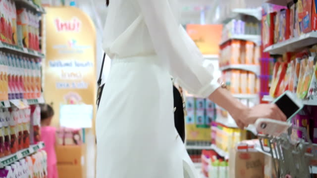 Woman shopping in supermarket,Slow motion