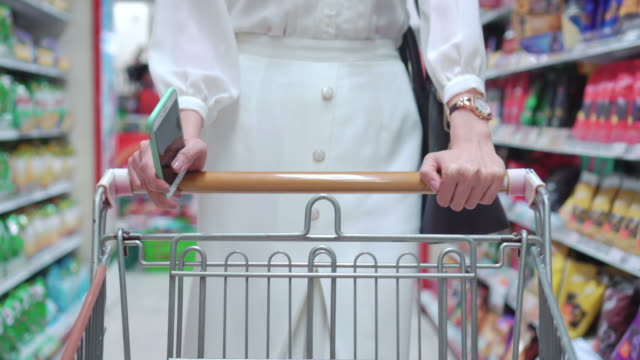 Woman shopping in supermarket,Steadicam shot