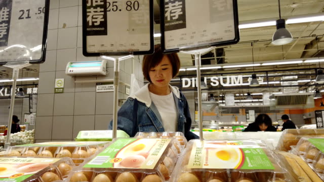 woman shopping in supermatket - bakery stock videos and b-roll footage