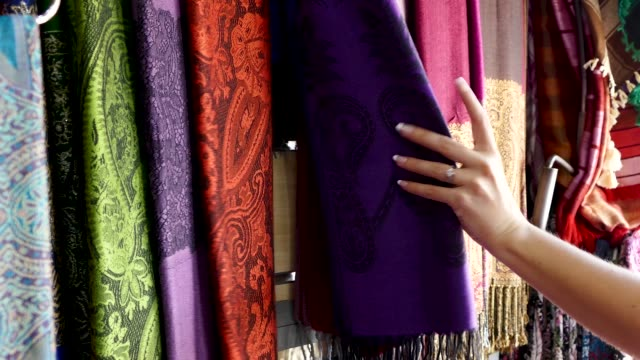 woman shopping inspecting scarves central square market stalls marrakesh morocco - silk stock videos & royalty-free footage