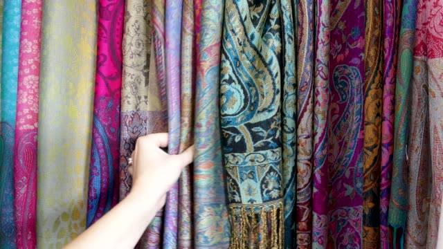 woman shopping inspecting textiles central square market stalls marrakesh morocco - scarf stock videos & royalty-free footage