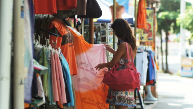 woman shopping on a costa rican street - souvenir stock videos and b-roll footage