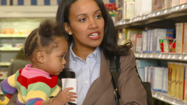 CU, Woman shopping with daughter (12-17 months), Richmond, Virginia, USA