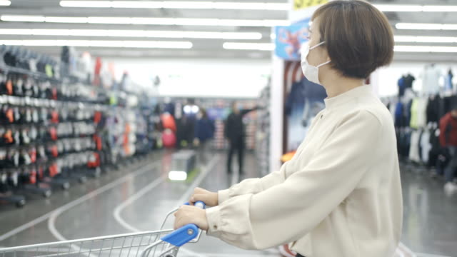 woman shopping with mask - retail stock videos & royalty-free footage