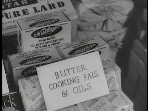 a woman shops in a local market using food rationing stamps - food stamps stock videos & royalty-free footage