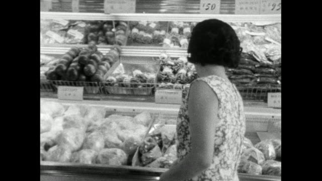 woman shops in japanese supermarket; 1966 - only mid adult women stock videos & royalty-free footage