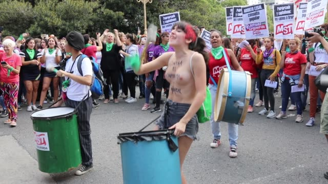 woman shouts slogans against gender violence during a demonstration as part of the international women's day on march 8, 2019 in buenos aires,... - argentina stock-videos und b-roll-filmmaterial