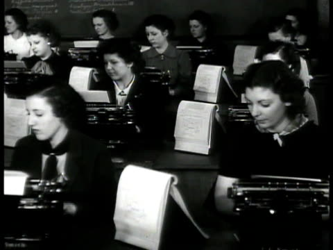 woman showing another cloth room of women typing on typewriters statue of liberty boat boarding polar bears in central park zoo ws industry on... - central park zoo stock-videos und b-roll-filmmaterial