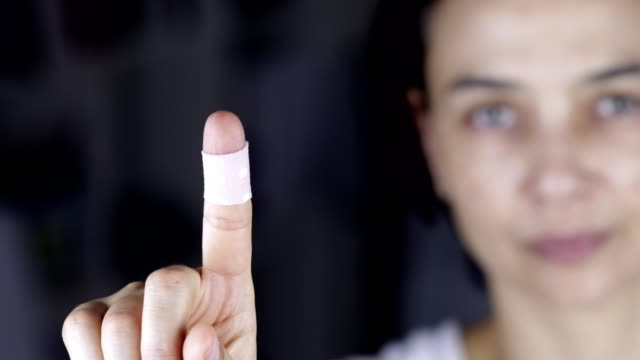 woman showing finger with bandage, patch - wound stock videos & royalty-free footage