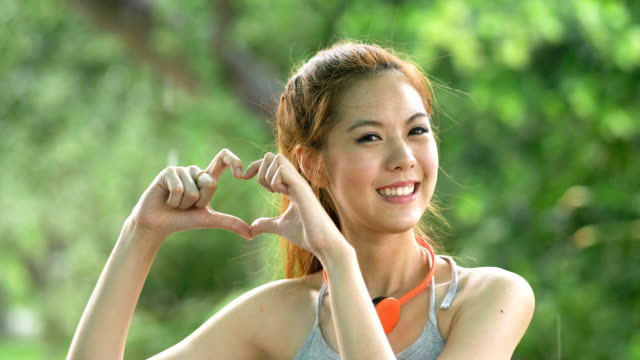 Woman showing heart sign with her hands