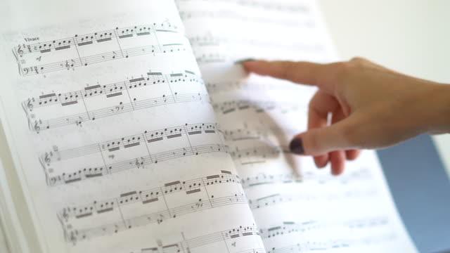 woman showing sheet music - sheet music stock videos & royalty-free footage